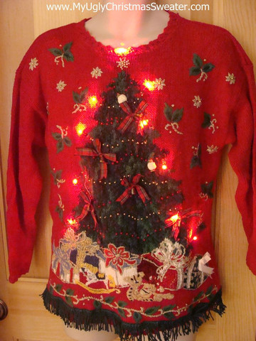 youll really light up the room with a light up christmas sweater